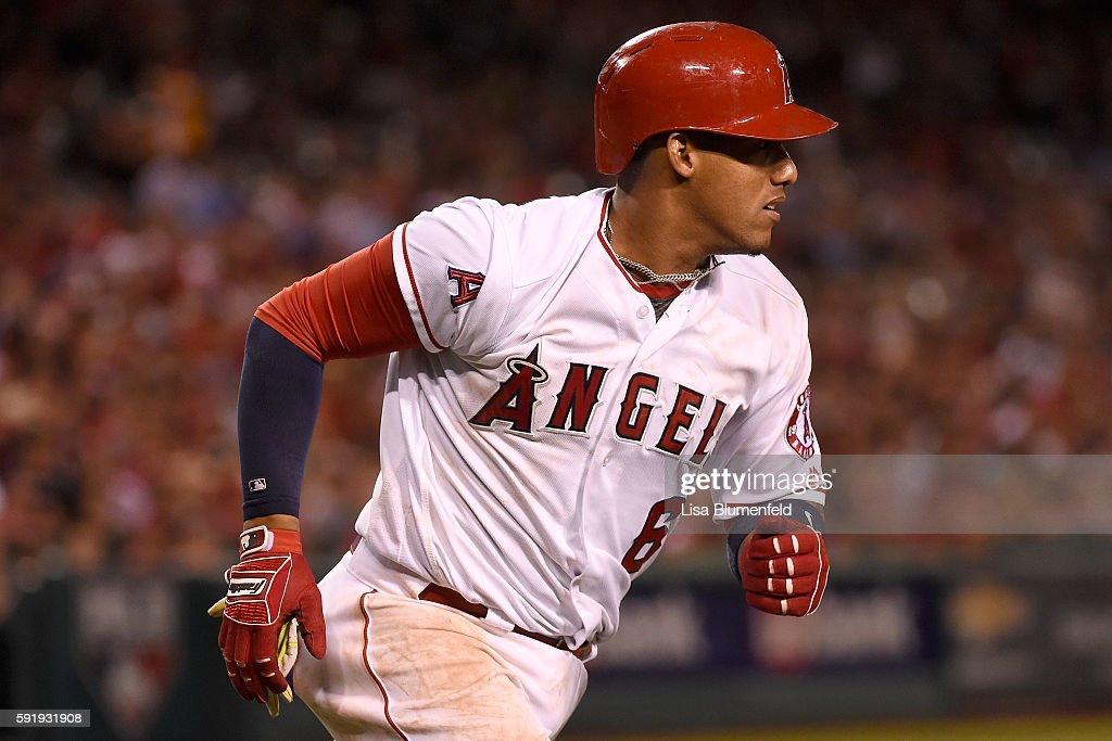 Yunel Escobar #6 of the Los Angeles Angels of Anaheim runs to first base after hitting a single in the fifth inning against the Seattle Mariners at Angel Stadium of Anaheim on August 18, 2016 in Anaheim, California.
