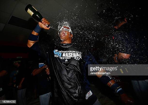 Yunel Escobar of the Tampa Bay Rays celebrates in the clubhouse following their 40 win against the Cleveland Indians during the American League Wild...