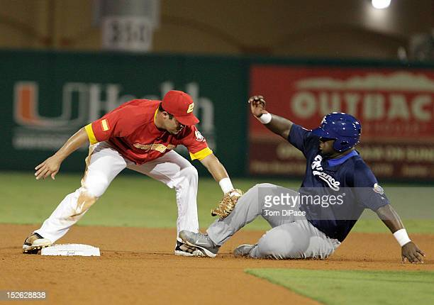 Yunesky Sanchez of Team Spain tags out Rene Leveret of Team France to complete a double play during game 2 of the Qualifying Round of the 2013 World...