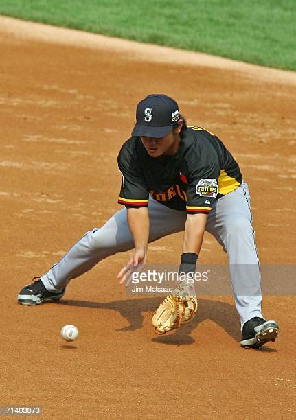 Yung Chi Chen of the World Team fields a ground ball against the U.S.A. Team during the XM Satellite Radio All-Star Futures Game at PNC Park on July...