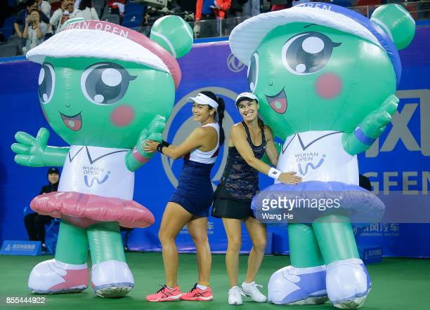 Yung jan Chan of Chinese Taipei and Martina Hingis of Switzerland celebrate following their victory during the Ladies Doubles semi final against...