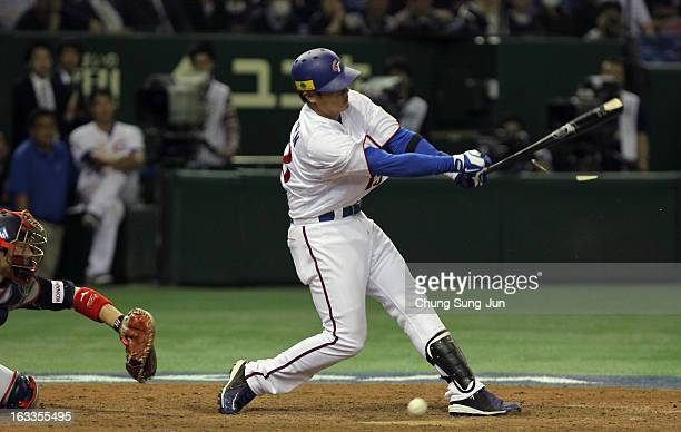 YungChi Chen of Chinese Taipei bats in the tenth inning during the World Baseball Classic Second Round Pool 1 game between Japan and Chinese Taipei...