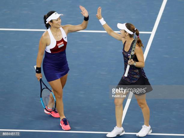 Yung-Jan Chan of Chinese Taipei and Martina Hingis of Switzerland celebrate following their victory during the Ladies Doubles semi final against...