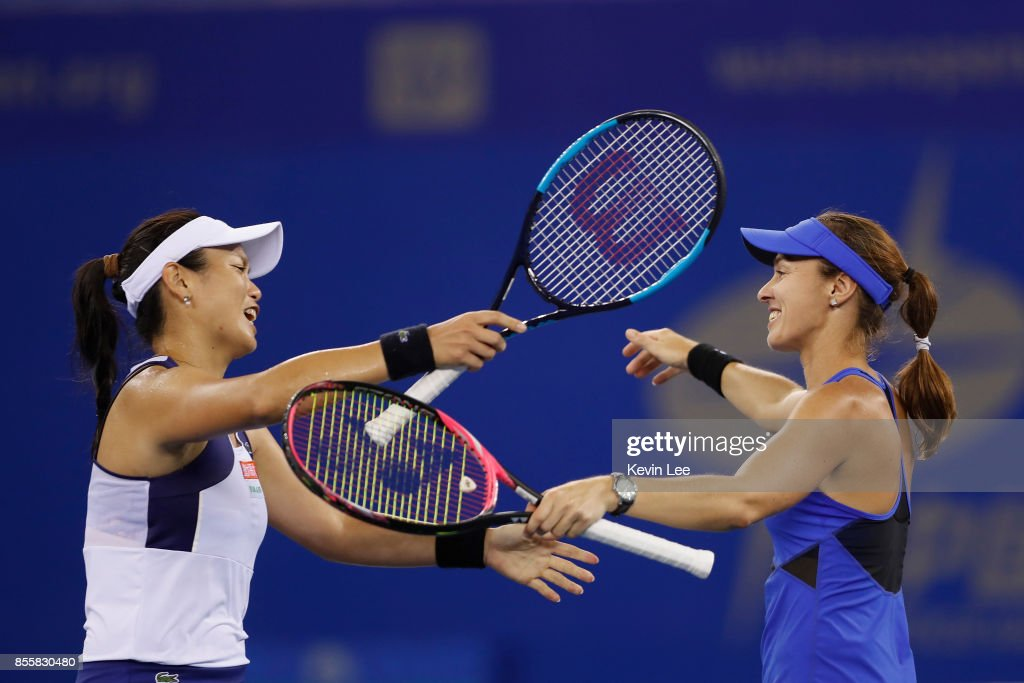 Yung-Jan Chan of Chinese Taipei and Martina Hingis of Switzerland celebrate their victory during the Ladies Doubles final against Shuko Aoyama of Japan and Zhaoxuan Yang of China on September 30, 2017 in Wuhan, China.