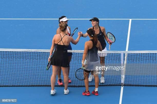 YungJan Chan of Chinese Taipei and Martina Hingis of Switzerland shake hands with Gabriela Dabrowski of Canada and Yifan Xu of China after winning...