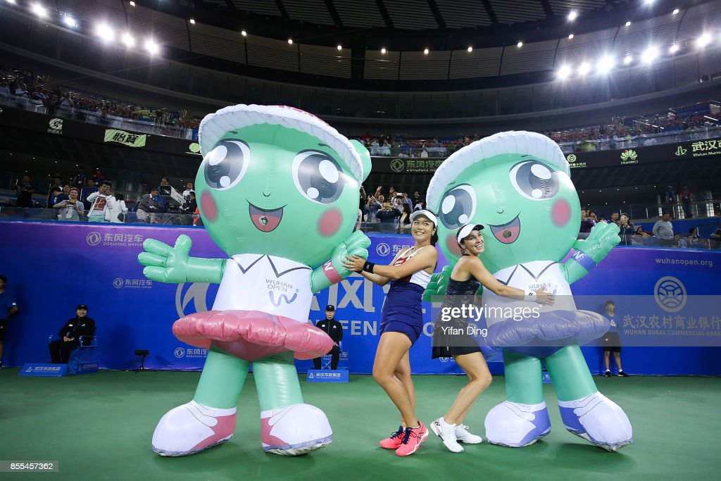 Yung-jan Chan of Chinese Taipei and Martina Hingis of Switzerland pose with the mascot after winning the he Ladies Doubles semi final match between Yung-jan Chan of Chinese Taipei and Martina Hingis of Switzerland and Sania Mirza of India and Peng Shuai of China at the Women's Double of 2017 Dongfeng Motor Wuhan Open at Optics Valley International Tennis Center on September 29, 2017 in Wuhan, China.
