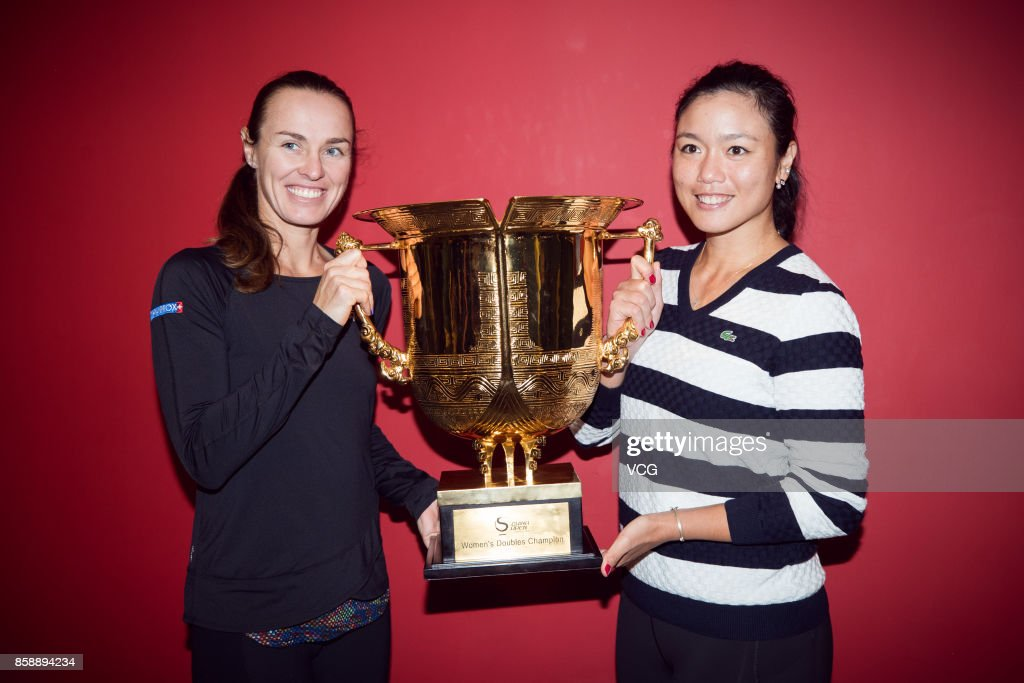 Yung-Jan Chan (R) of Chinese Taipei and Martina Hingis of Switzerland pose with the trophy after winning the Women's doubles final match against Timea Babos of Hungary and Andrea Hlavackova of the Czech Republic on day nine of 2017 China Open at the China National Tennis Centre on October 8, 2017 in Beijing, China.