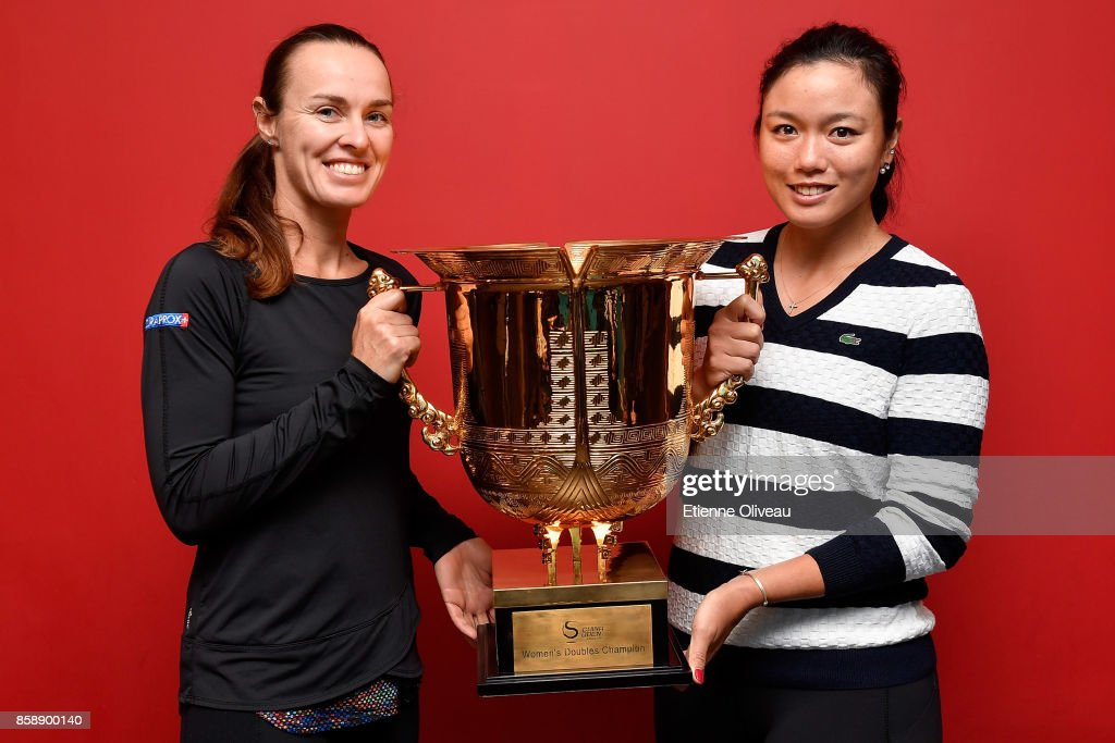 Yung-Jan Chan of Chinese Taipei and Martina Hingis of Switzerland pose for a picture holding the winners trophy after winning the Women's Doubles Final against Timea Babos of Hungary and Andrea Hlavackova of Czech Republic on day nine of the 2017 China Open at the China National Tennis Centre on October 8, 2017 in Beijing, China.