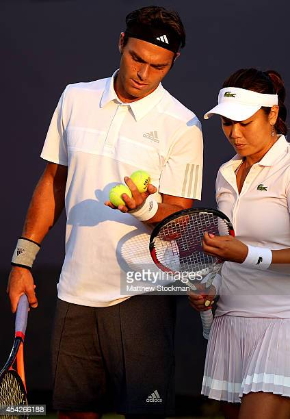 Yung-Jan Chan of Chinese Taipei and Ross Hutchins of Great Britain talk during their mixed doubles match on Day Three of the 2014 US Open at the USTA...
