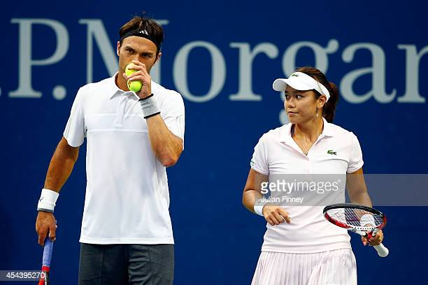 Yung-Jan Chan of Chinese Taipei and Ross Hutchins of Great Britain speak during their mixed doubles second round match against Melanie Oudin of the...