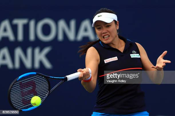 YungJan Chan of Chinese Taipei hits a shot with her doubles partner Martina Hingis of Switzerland against Andreja Klepac of Slovenia and María José...