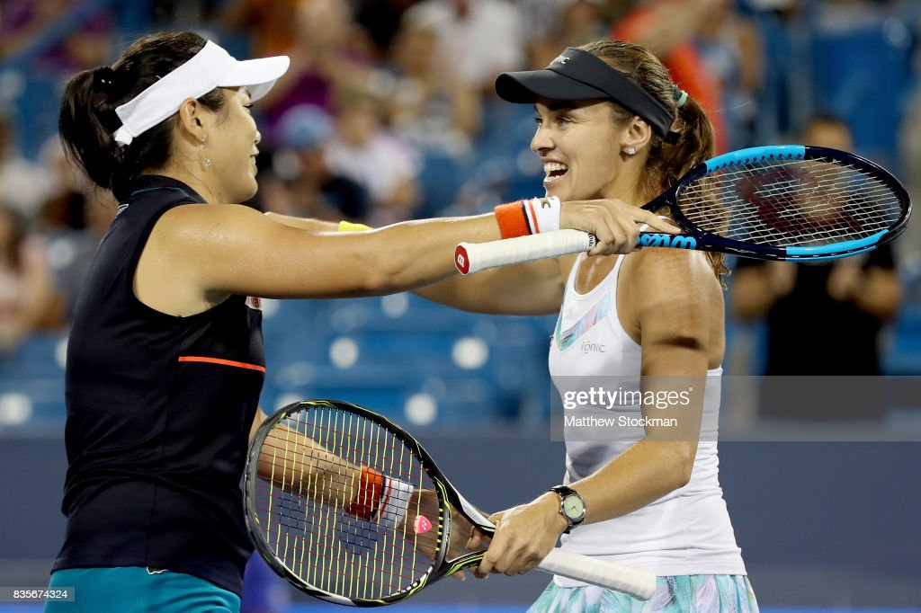 Yung-Jan Chan of Taipei and Martina Hingis of Switzerland celebrate match point against Su-Wei Hsieh of Taipei and Monica Niculescu of Romania in the women's double final during day 8 of the Western & Southern Open at the Lindner Family Tennis Center on August 19, 2017 in Mason, Ohio.