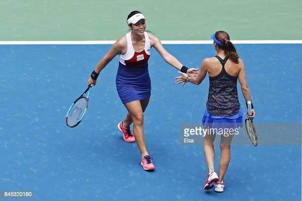YungJan Chan of Taiwan and Martina Hingis of Switzerland react against Lucie Hradecka of Czech Republic and Katerina Siniakova of Czech Republic...