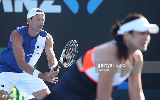 YungJan Yang of Taipei and Lukasz Kubot of Poland compete in their first round match against Daria Gavrillova and Luke Saville of Australia on day...