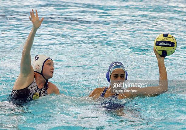 Yunieska Diago of Cuba makes a pass under pressure from Anna Zubkova of Kazakhstan during the Women's Final Round Water Polo match between Kazakhstan...