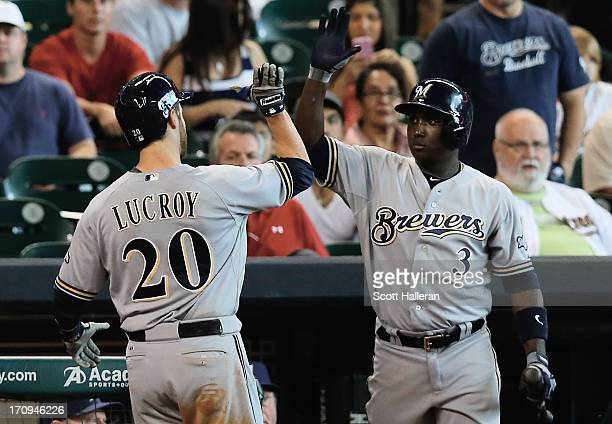 Yuniesky Betancourt and Jonathan Lucroy of the Milwaukee Brewers celebrate after Lucroy hits a solo home run in the sixth inning during the game...