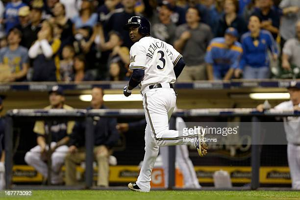 Yuniesky Betancourt of the Milwaukee Brewers watches this ball go over the wall for a solo home run in the bottom of the fifth inning against the...