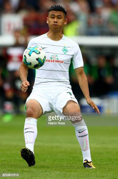 Yuning Zhang of Bremen runs with the ball during the preseason friendly match between FC St Pauli and Werder Bremen at Millerntor Stadium on July 22...