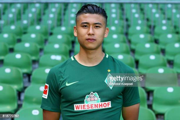 Yuning Zhang of Werder Bremen poses during the team presentation at Weser Stadium on July 19 2017 in Bremen Germany