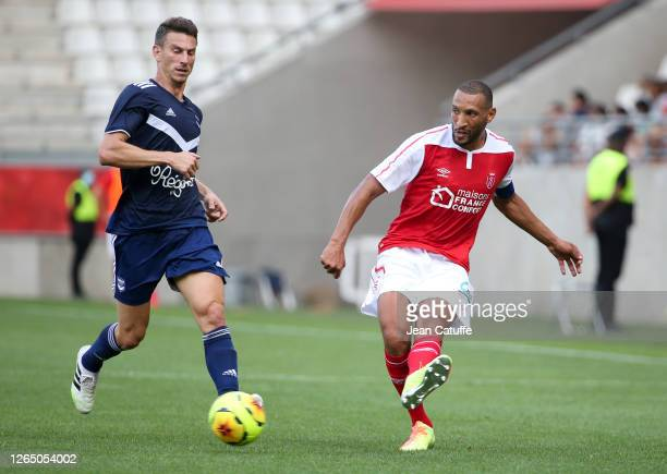Yunis Abdelhamid of Reims, Laurent Koscielny of Bordeaux during the pre-season friendly match between Stade de Reims and FC Girondins Bordeaux at...