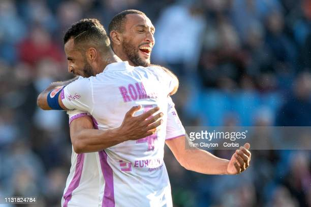 Yunis Abdelhamid of Stade de Reims and Alaixys Romao of Stade de Reims celebrate their sides victory at the final whistle during the Montpellier Vs...