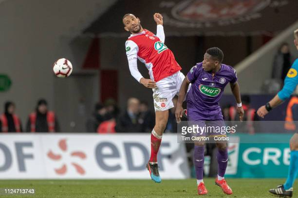 Yunis Abdelhamid of Stade de Reims heads clear while challenged by Aaron Leya Iseka of Toulouse during the Toulouse FC V Stade de Reims Coupe de...