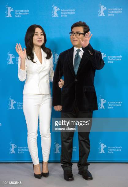 Yunjin Kim US actor born inSouth Korea and director JK Youn pose during a photoshoot for 'Ode to My Father' at the 65th International Film Festival...