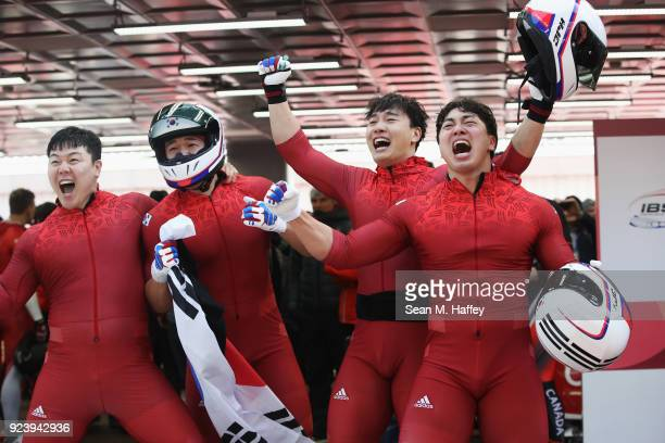 Yunjong Won Junglin Jun Seo Youngwoo and Donghyun Kim of Korea celebrate after they finish their final run during the 4man Boblseigh heats on day...