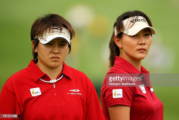 Yun-Jye Wei and Amy Hung of Taiwan look on from the 17th green during the final round of the Women's World Cup of Golf at The Gary Player Country...