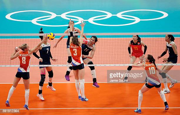 Yunli Xu of China strikes the ball at the Netherlands defence during the Women's Volleyball Semifinal match at the Maracanazinho on Day 13 of the...