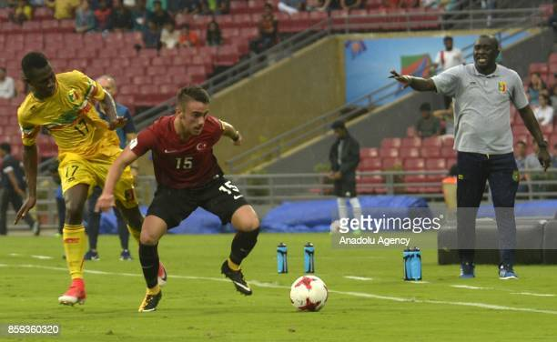 Yunus Akgün of Turkey is in action against Mamadou Samake of Mali during the ceremony within a 2017 FIFA U17 World Cup football match between Turkey...