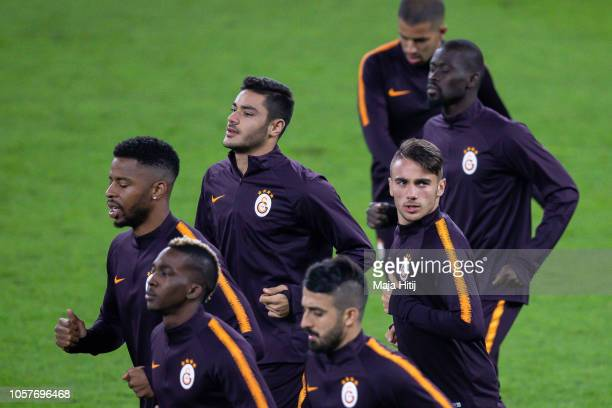 Yunus Akgun of Galatasaray and players of Galatasaray run during the Training prior to the Group D match of the UEFA Champions League between FC...