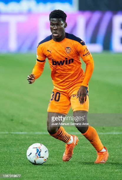 Yunus Dimoara Musah of Valencia CF in action during the LaLiga Santander match between Alaves and Valencia on November 22, 2020 in Vitoria-Gasteiz,...
