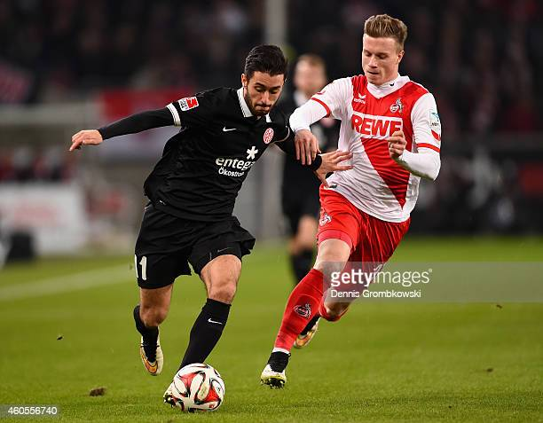 Yunus Malli of 1 FSV Mainz 05 and Yannick Gerhardt of 1 FC Koeln battle for the ball during the Bundesliga match between 1 FC Koeln and 1 FSV Mainz...