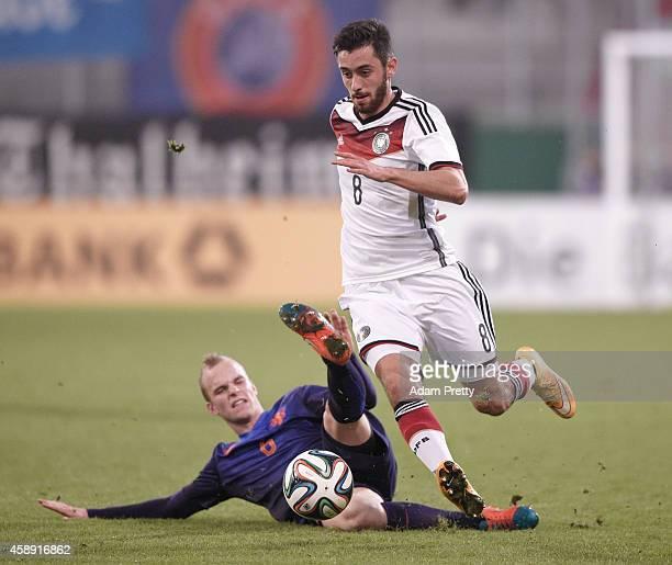 Yunus Malli of Germany is tackled by Jorrit Hendrix of the Netherlands during the U21 Germany v U21 Netherlands International Friendly match at Audi...