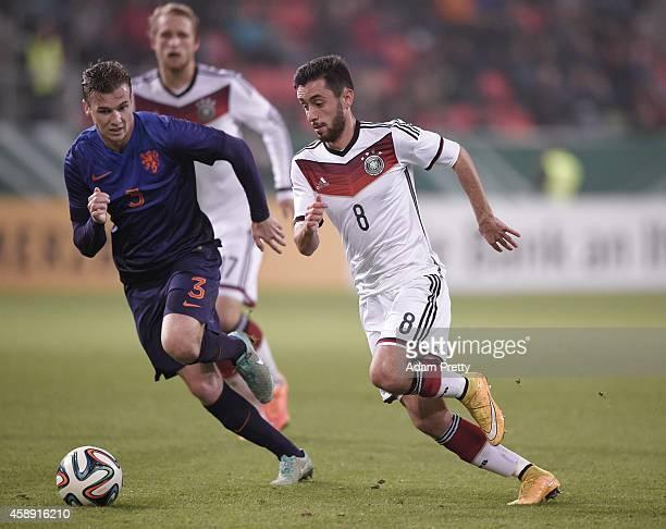 Yunus Malli of Germany is tracked by Peet Bijen of the Netherlands during the U21 Germany v U21 Netherlands International Friendly match at Audi...