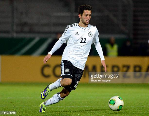 Yunus Malli of Germany runs with the ball during the U21 Euro qualifier group 6 match between Germany and Republic of Montenegro at Brita Arena on...