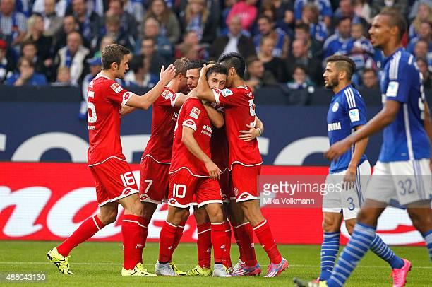 Yunus Malli of Mainz celebrates scoring the 11 with Yoshinori Muto of Mainz and teammates during the Bundesliga match between FC Schalke 04 and 1 FSV...