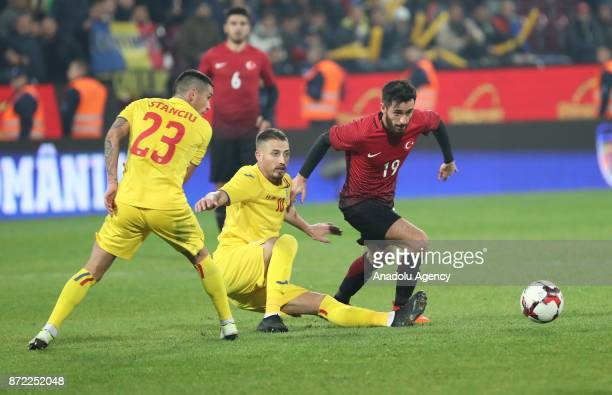 Yunus Malli of Turkey in action against Stanciu of Romania during the friendly match between Romania and Turkey at Dr Constantin Radulescu Stadium in...