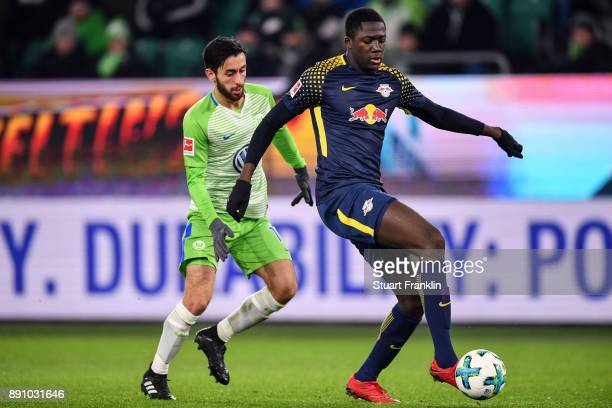 Yunus Malli of VfL Wolfsburg and Ibrahima Konate of RB Leipzig battle for the ball during the Bundesliga match between VfL Wolfsburg and RB Leipzig...