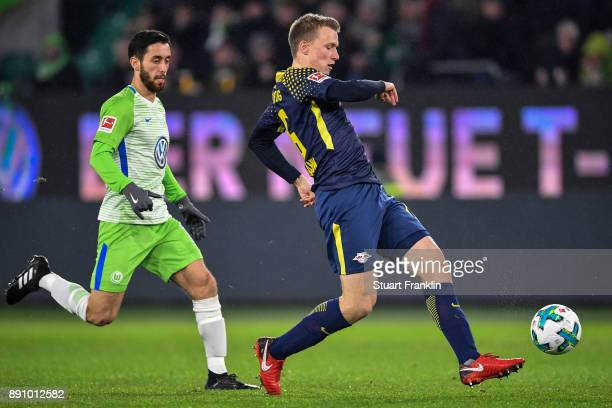 Yunus Malli of VfL Wolfsburg and Lukas Klostermann of RB Leipzig battle for the ball during the Bundesliga match between VfL Wolfsburg and RB Leipzig...