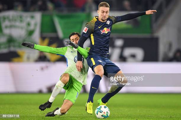 Yunus Malli of VfL Wolfsburg and Stefan Ilsanker of RB Leipzig battle for the ball during the Bundesliga match between VfL Wolfsburg and RB Leipzig...