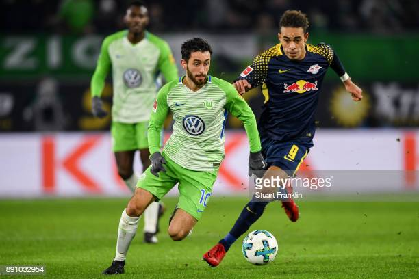 Yunus Malli of VfL Wolfsburg and Yussuf Poulsen of RB Leipzig battle for the ball during the Bundesliga match between VfL Wolfsburg and RB Leipzig at...