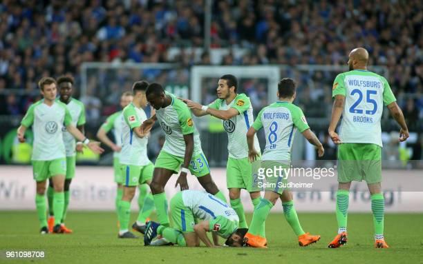 Yunus Malli of VfL Wolfsburg celebrate their teams not given goal during the Bundesliga Playoff Leg 2 between Holstein Kiel and VfL Wolfsburg at...