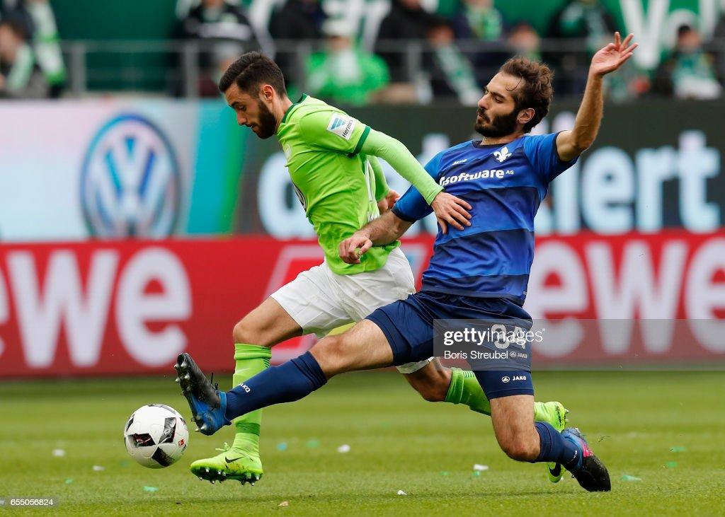 Yunus Malli of VfL Wolfsburg is challenged by Hamit Altintop of SV Darmstadt 98 during the Bundesliga match between VfL Wolfsburg and SV Darmstadt 98 at Volkswagen Arena on March 18, 2017 in Wolfsburg, Germany.