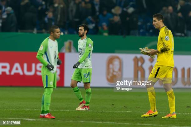 Yunus Malli of Wolfsburg and Goalkeeper Koen Casteels of Wolfsburg look dejected after the DFB Cup match between FC Schalke 04 and VfL Wolfsburg at...