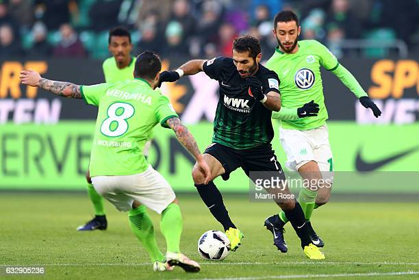Yunus Malli of Wolfsburg and Halil Altintop of Augsburg battle for the ball during the Bundesliga match between VfL Wolfsburg and FC Augsburg at...