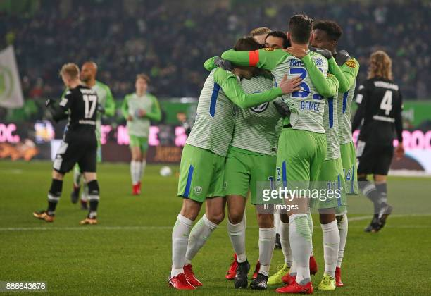 Yunus Malli of Wolfsburg celebrates after scoring his team`s first goal with team mates during the Bundesliga match between VfL Wolfsburg and...