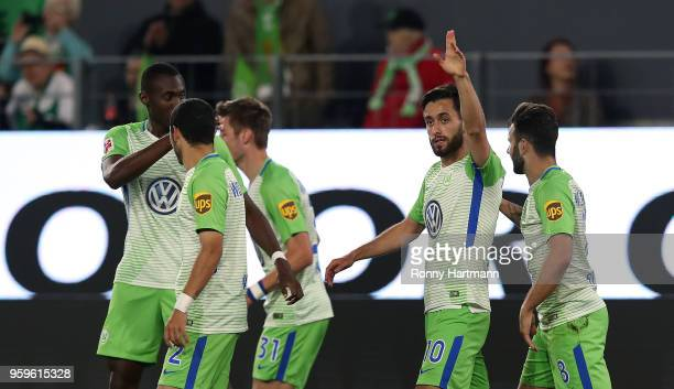 Yunus Malli of Wolfsburg celebrates after scoring his team's third goal with team mates during the Bundesliga Playoff Leg 1 match between VfL...