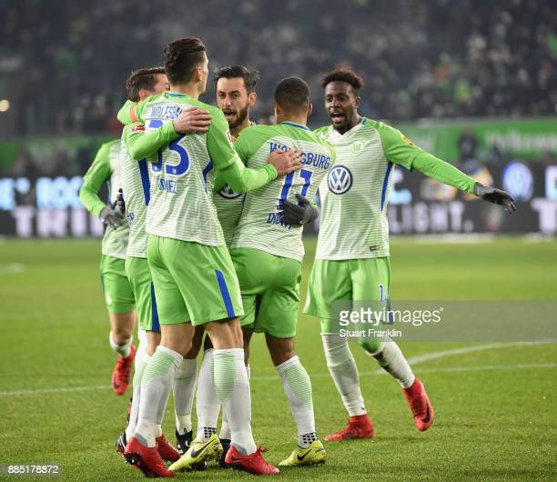 Yunus Malli of Wolfsburg celebrates scoring the first goal with his teamates during the Bundesliga match between VfL Wolfsburg and Borussia...